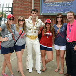 Elvis fans grab photos on their way to watch the Memphis Redbirds play during Elvis Night at Autozone Park in Memphis.