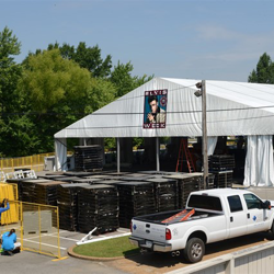 Crews bringing in flooring and the stage for the Elvis Week Main Stage on August 1, 2014.