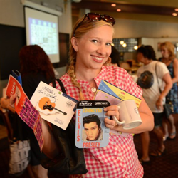 This Elvis fan walks away with prizes during Elvis Bingo on August 11, 2014.