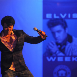 This semifinalist performs on stage during the Ultimate Elvis Tribute Artist Showcase.
