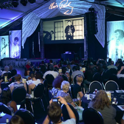 Elvis fans attend the Jailhouse Rock Movie and Dance Party inside the Elvis Week Main Stage on August 11, 2014.