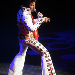 Elvis tribute artist compete for the top ten spot during the Ultimate Elvis Tribute Artist Contest Semifinal on August 12, 2014.