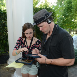 Fans search for clues during the New Graceland iPad Trivia Tour on August 12, 2014.