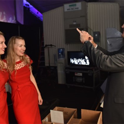 Host Joey Sulipeck snaps a photo of Gladys & Maybelle backstage at the Elvis Love Songs show.