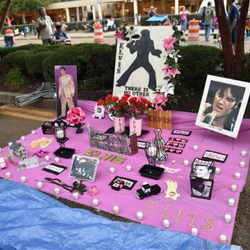 Fans create tributes to Elvis at the Candlelight Vigil.