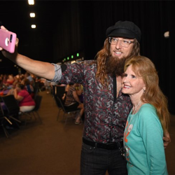 Memphis Jones snaps selfies with fans at the Elvis Fan Reunion.
