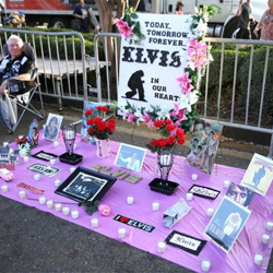 Fans make Elvis tributes during the Candlelight Vigil.