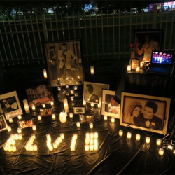 Elvis tributes line Elvis Presley Boulevard during the Candlelight Vigil.