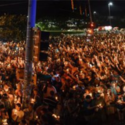 Thousands of fans participate in the Candlelight Vigil.