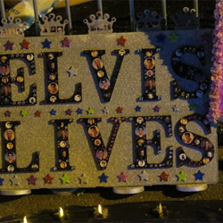 Fans created shrines and tributes to Elvis on Elvis Presley Boulevard the night of the Candlelight Vigil.