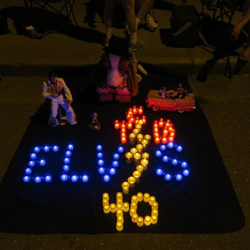 Fans made tributes and shrines for Elvis along Elvis Presley Boulevard in front of Graceland.