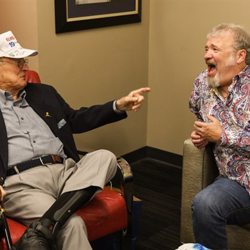 Host Tom Brown and Rex Mansfield share a laugh backstage.
