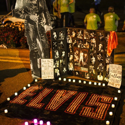 Fans make tributes to Elvis at the Candlelight Vigil.