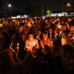 Thousands of fans from around the world attend Candlelight Vigil.