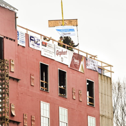 A Topping Out Ceremony is a construction tradition in which the last beam is put into place at a construction site. The Guest House at Graceland