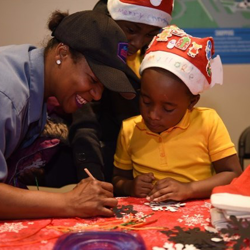Kids enjoyed making ornaments and Santa hats after the Lighting Ceremony.