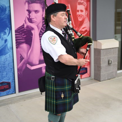 "This bag piper player performed ""Love Me Tender."""