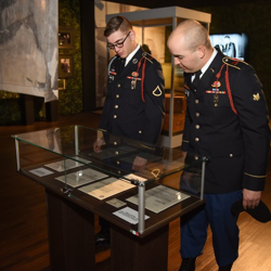 Members of Elvis' Army unit, the 1st Squadron, 32nd Cavalry Regiment check out artifacts in the Private Presley exhibit.