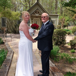 Linda Clarke and Davis Mason of Birmingham, United Kingdom were married at the Chapel at Graceland on April 9, 2015.