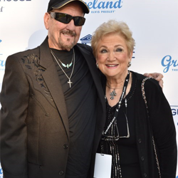 TCB band member James Burton and his wife Louise walked the blue carpet.
