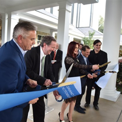 The Guest House at Graceland manager Keith Hess, Graceland CEO Jack Soden, Priscilla Presley and Joel Weinshanker, Joel Weinshanker, Managing Partner, Graceland Holdings, LLC, officially open The Guest House at Graceland at a ribbon cutting ceremony.