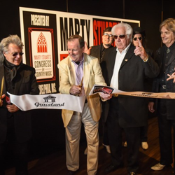 Marty Stuart, Graceland CEO Jack Soden, and Sun Records drummer W.S. Holland celebrate the grand opening of Stuart