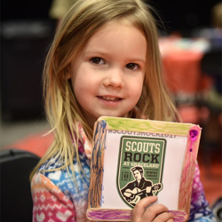 Scouts made cards for the troops, as well as colorful picture frames, during Scouts Rock.