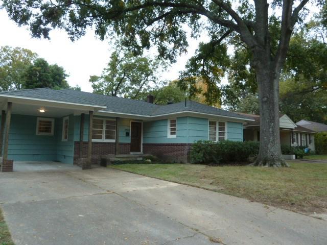 brick house with turquoise siding