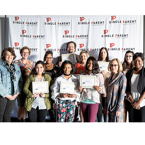Scholarship recipients pose as group with certificates