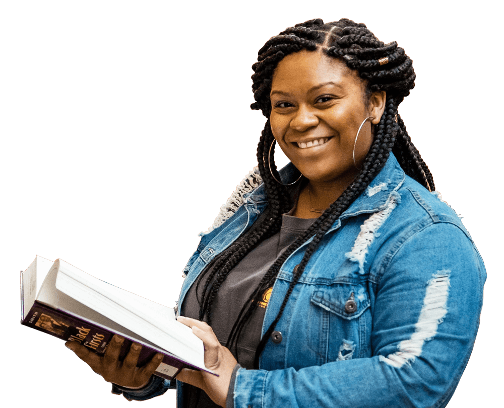 black woman holding a book