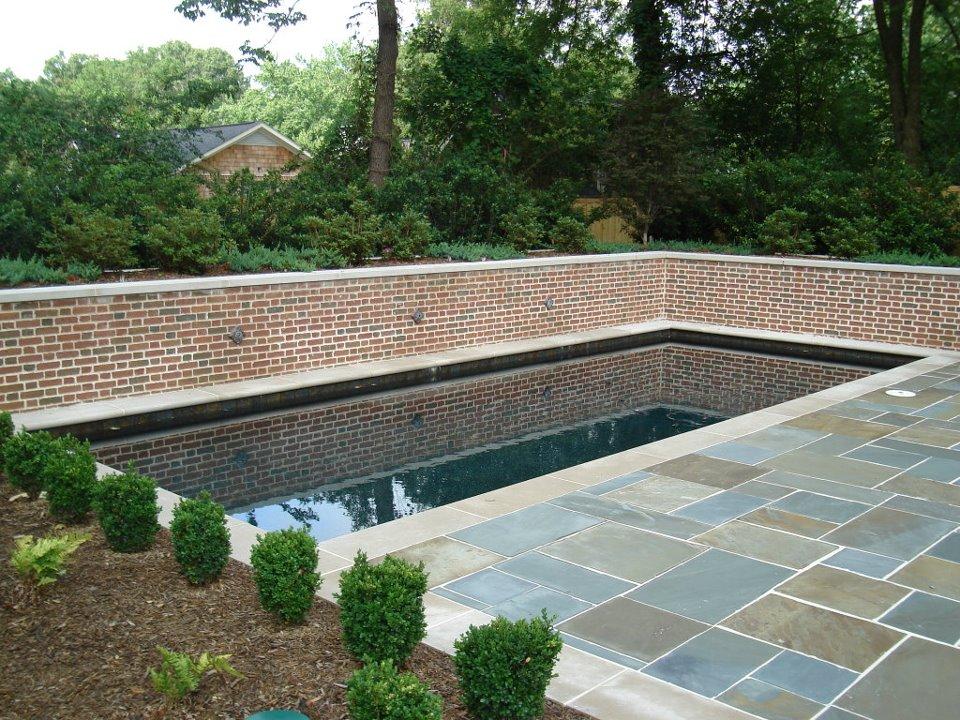 pool and brick wall