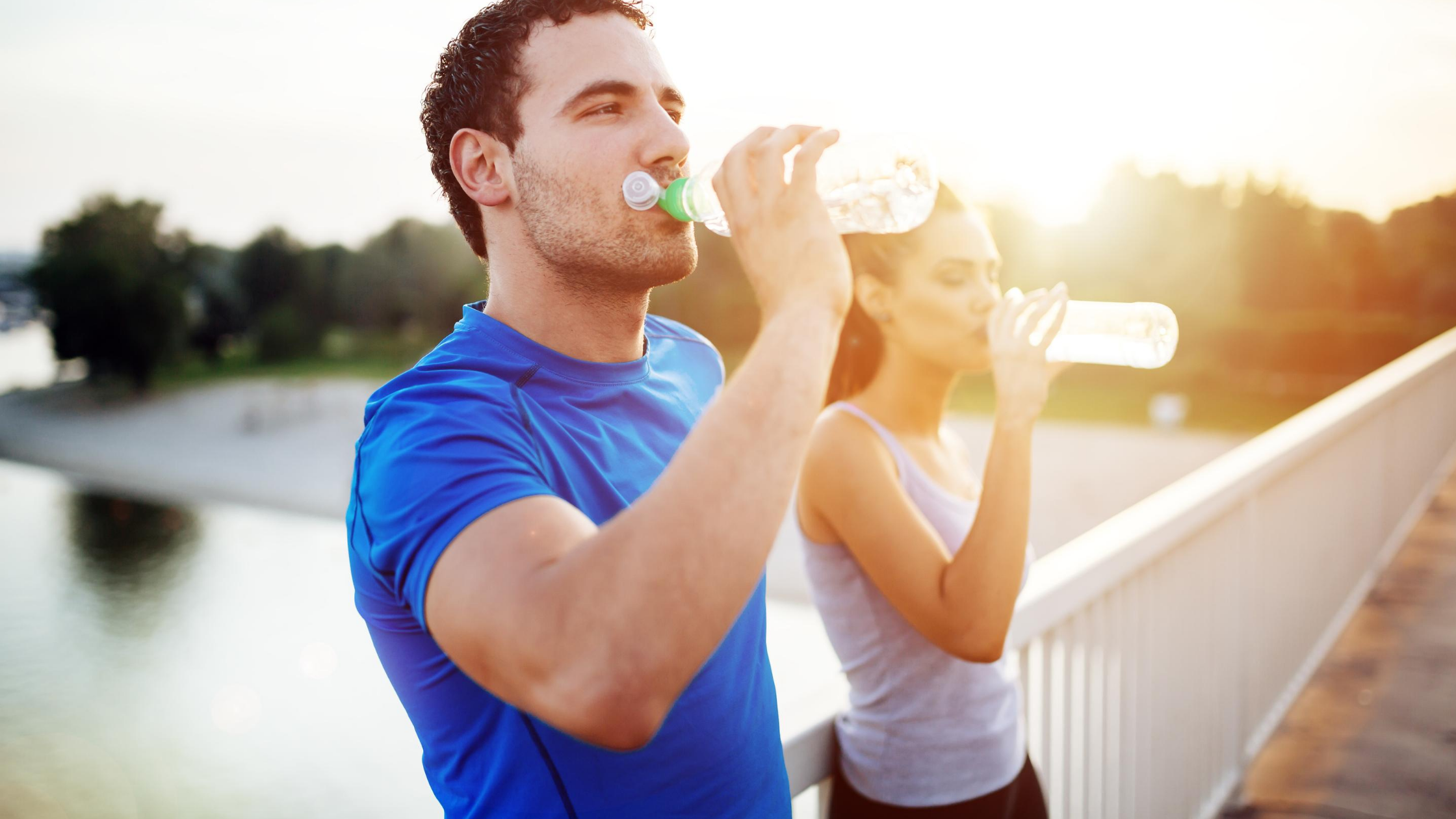 man and woman hydrating
