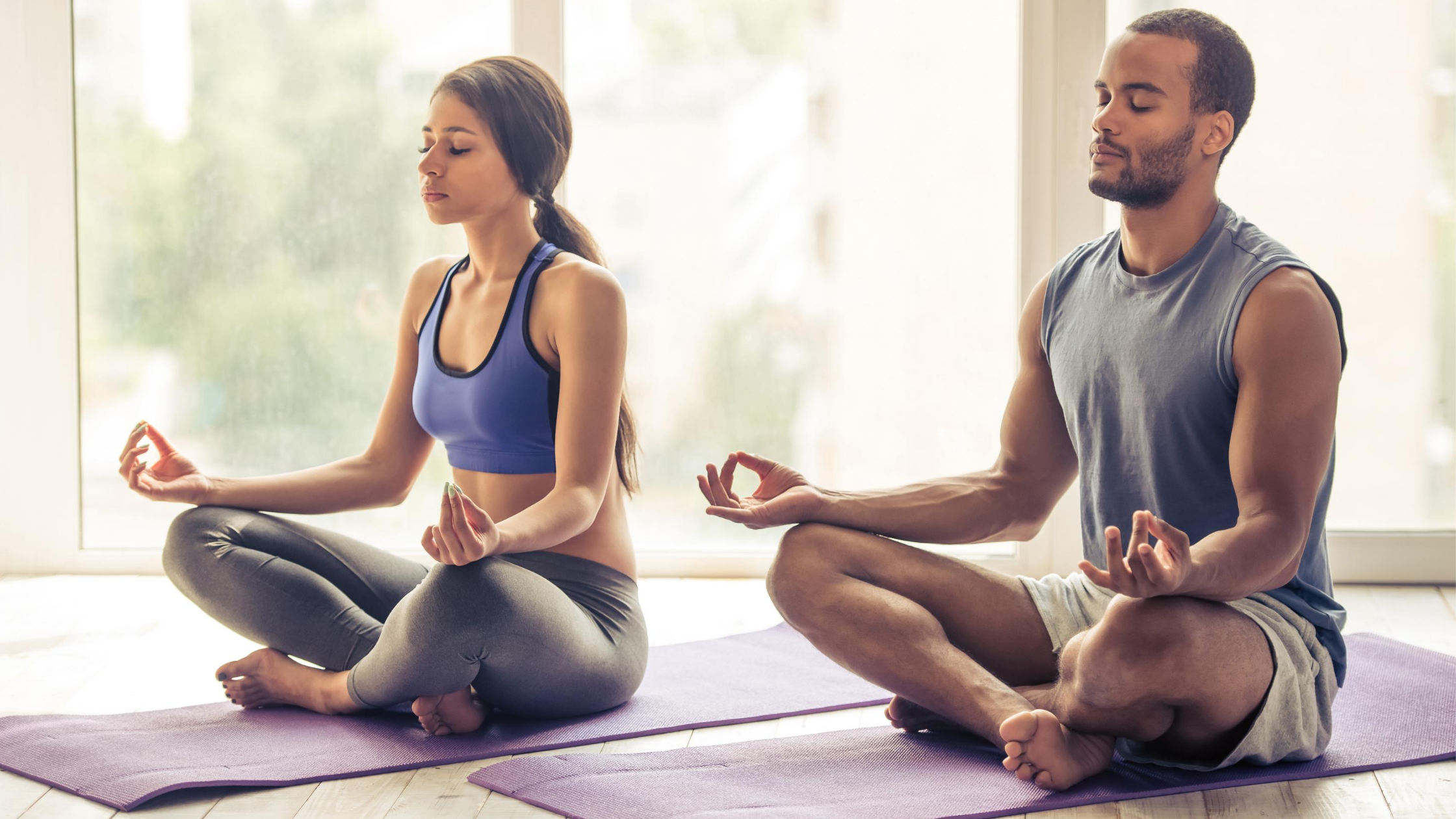 two couples practicing yoga