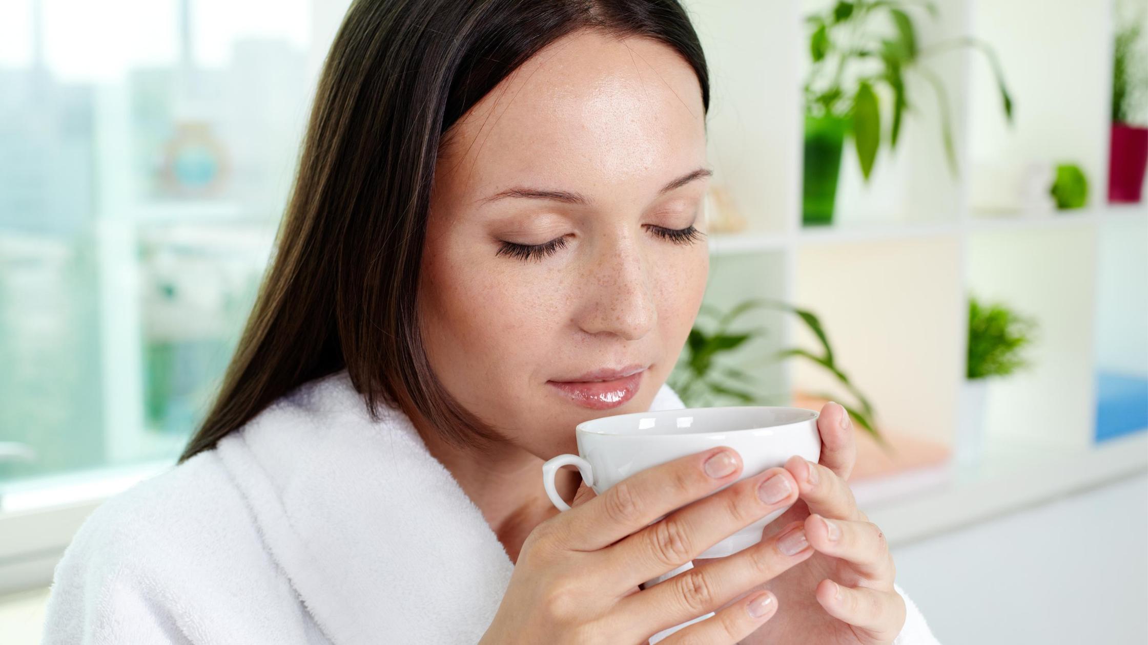 woman in spa breathing in tea