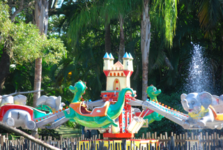 Flying elephant amusement ride running.