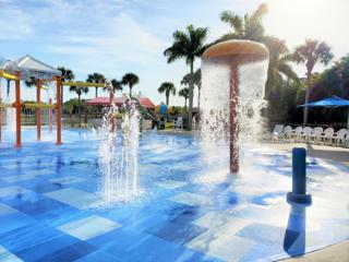 Safari splash sprayground with water running from features.