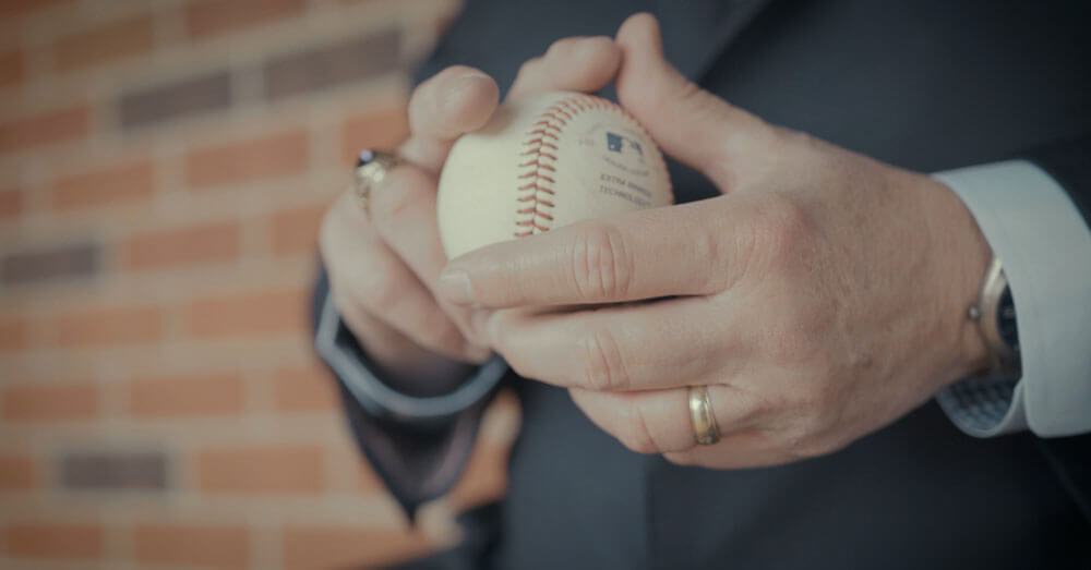 man holding baseball in hand